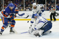 Tampa Bay Lightning goaltender Andrei Vasilevskiy (88) blocks a shot by New York Islanders center Mathew Barzal (13) during the third period of Game 3 of the NHL hockey Stanley Cup semifinals, Thursday, June 17, 2021, in Uniondale, N.Y. Tampa Bay won 2-1.(AP Photo/Frank Franklin II)