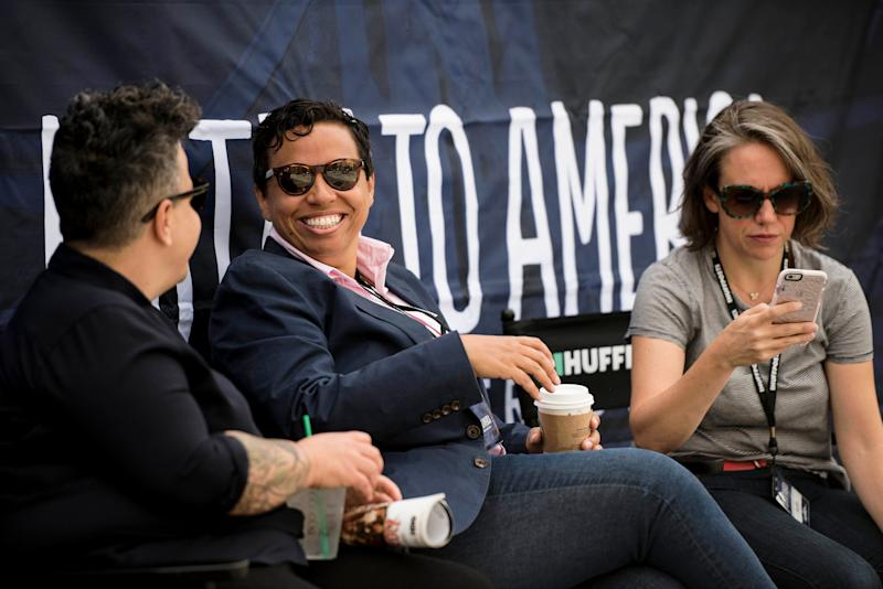 """HuffPost Editor-in-Chief Lydia Polgreen with her wife, Candy Feit, left, and strategy director Hillary Frey talk before the """"Listen to America: A HuffPost Road Trip"""" kickoff event."""