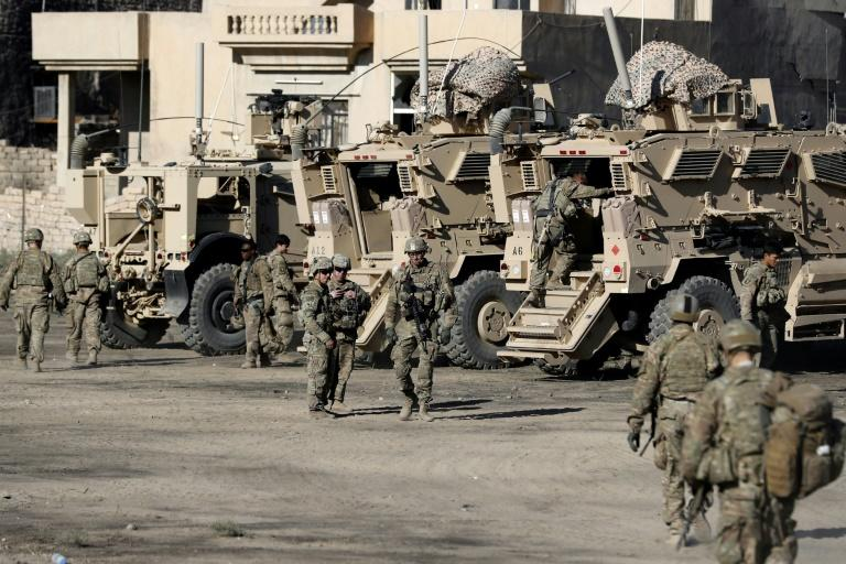 US soldiers are seen in November 2016 next to their armoured vehicles near an Iraqi army base on the outskirts of Mosul, the capital of Nineveh province, where the deadly incident took place