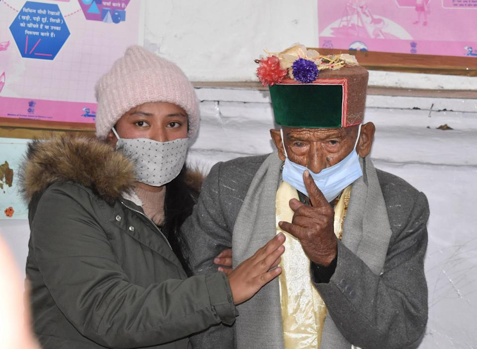 Shyam Saran Negi, believed to be India's oldest voter at 103 years of age, shows his inked finger after casting vote for Panchayat elections, at Kalpa in Kinnaur, on Sunday, 17 January 2021.