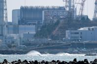<p>The Tokyo Electric Power Company Holdings (TEPCO) Fukushima Daiichi nuclear power plant is seen from the coast of Futaba town in Fukushima prefecture on March 10, 2021, on the eve of the 10th anniversary of the 9.0-magnitude earthquake which triggered a tsunami and nuclear disaster which killed over 18,000 people. (Photo: KAZUHIRO NOGI/AFP via Getty Images)</p>