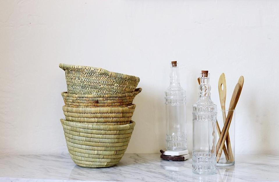 """<p>The handmade <a href=""""https://www.popsugar.com/buy/Lynn-Woven-Basket-582483?p_name=Lynn%20Woven%20Basket&retailer=effortlesscomposition.com&pid=582483&price=26&evar1=casa%3Aus&evar9=47553754&evar98=https%3A%2F%2Fwww.popsugar.com%2Fhome%2Fphoto-gallery%2F47553754%2Fimage%2F47553850%2FLynn-Woven-Basket&list1=shopping%2Chome%20decorating%2Chome%20shopping&prop13=api&pdata=1"""" class=""""link rapid-noclick-resp"""" rel=""""nofollow noopener"""" target=""""_blank"""" data-ylk=""""slk:Lynn Woven Basket"""">Lynn Woven Basket</a> ($26) comes in a smaller size that's handy to have in the kitchen.</p>"""