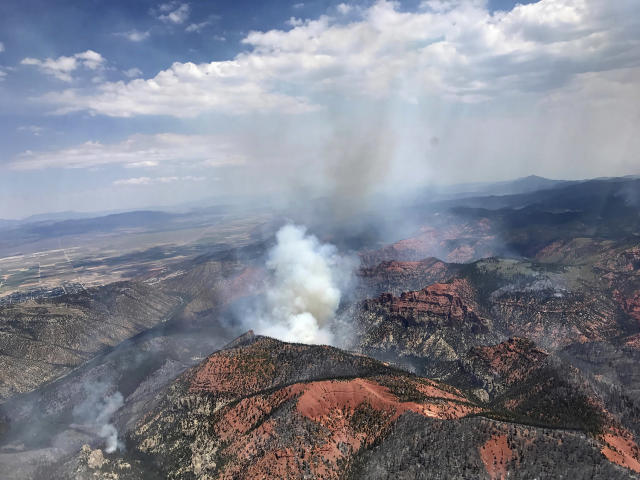 <p>This Monday, June 26, 2017, photo provided by the Utah Governor's Office, shows fire activity near Parowan, during a tour by Utah Lt. Gov. Spencer Cox, in southern Utah. (Justin Harding/Utah Governor's Office via AP) </p>