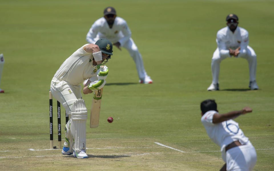 South Africa's Dean Elgarplays a shot, on day two of the first cricket test match between South Africa and Sri Lanka at Super Sport Park Stadium in Pretoria, South Africa, Sunday, Dec. 27, 2020. (AP Photo/Catherine Kotze)
