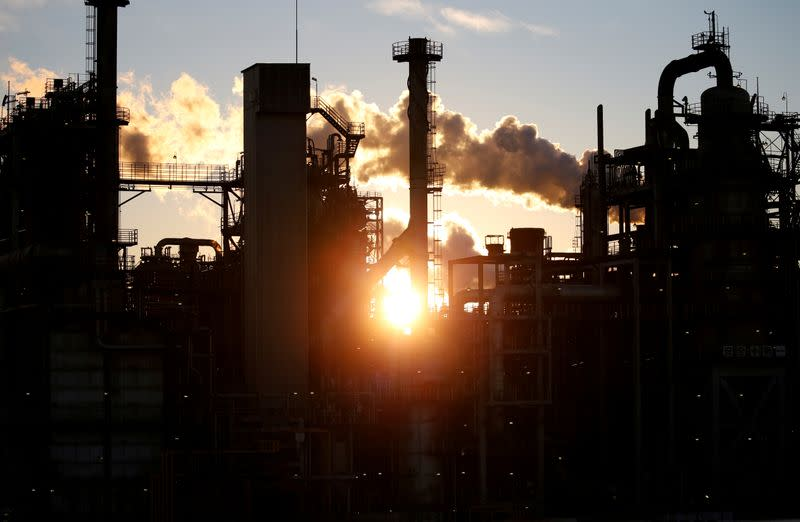 FILE PHOTO: Smoke rises from a factory during sunset at Keihin industrial zone in Kawasaki