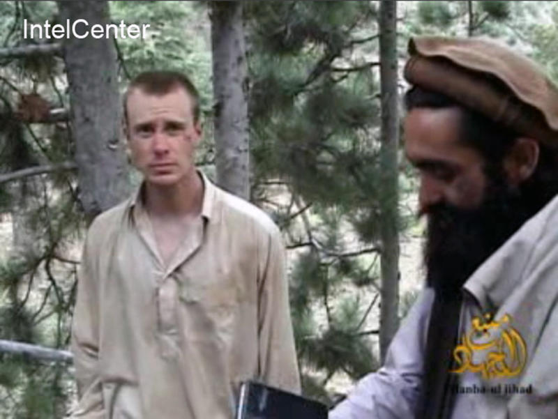"FILE - This file image provided by IntelCenter on Wednesday Dec. 8, 2010 shows a frame grab from a video released by the Taliban containing footage of a man believed to be Bowe Bergdahl, left. A Taliban spokesman, Shaheen Suhail, in an exclusive telephone interview with The Associated Press from the newly opened Taliban offices in Doha, Qatar, said Thursday, June 20, 2013, that they are ready to hand over U.S. soldier Pfc. Bowe R. Bergdahl held captive since 2009 in exchange for five of their senior operatives being held at the Guantanamo Bay prison. The U.S. is scrambling to save talks with the Taliban after angry complaints from Afghanistan President Hamid Karzai. (AP Photo/IntelCenter, File)  MANDATORY CREDIT: INTELCENTER; NO SALES; EDS NOTE: ""INTELCENTER"" AT LEFT TOP CORNER ADDED BY SOURCE"