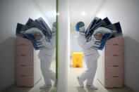 Medical worker carries protective suits at Jinyintan hospital in Wuhan, the epicentre of the novel coronavirus outbreak