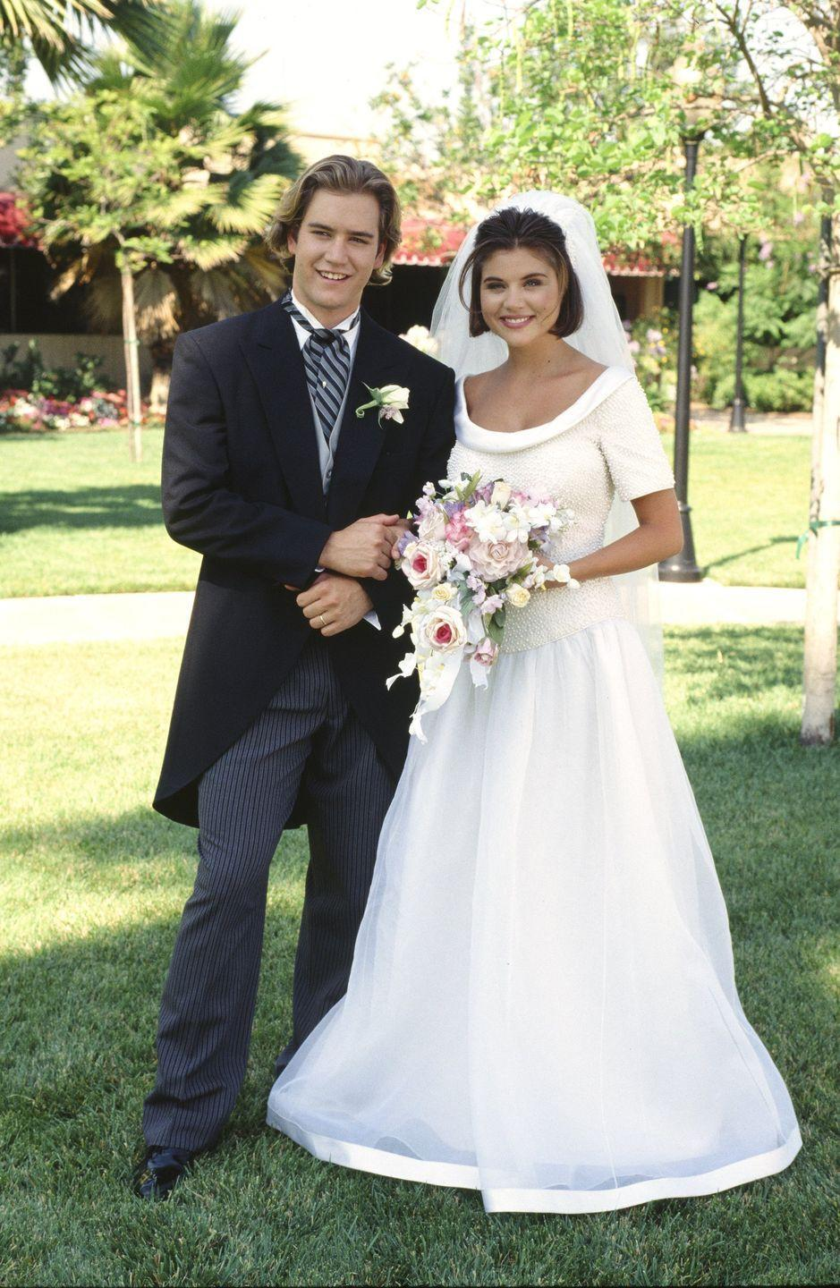 <p>First of all, if you didn't know <em>Saved by the Bell: The College Years </em>existed until now, you're welcome. Second of all, Kelly Kapowski's dress is un. real. But why am I surprised?</p>