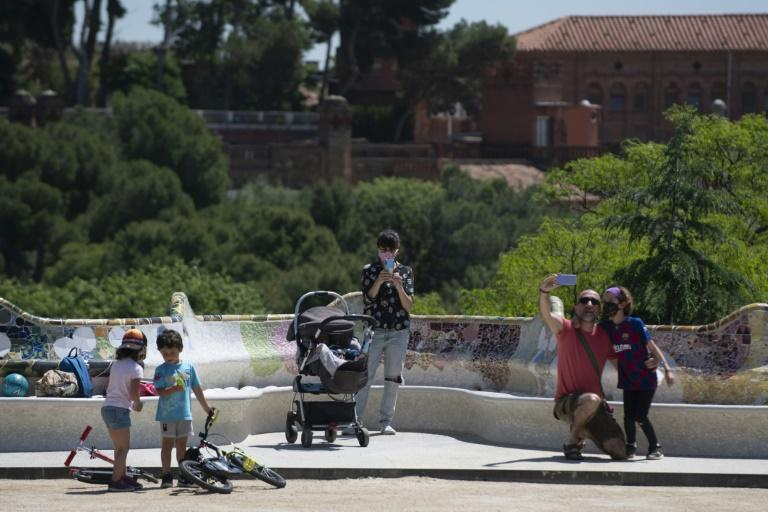 The locals take advantage of a beautiful day in a tourist-free Park Guell in Barcelona