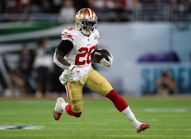 Feb 2, 2020; Miami Gardens, Florida, USA; San Francisco 49ers running back Tevin Coleman (26) runs with the ball in the first quarter against the Kansas City Chiefs in Super Bowl LIV at Hard Rock Stadium. Mandatory Credit: Matthew Emmons-USA TODAY Sports