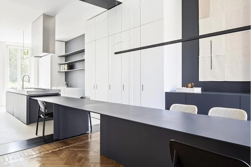 The kitchen island in the loft even extends to provide occupants with as much usable work space as possible.