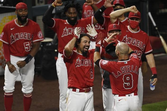 Los Angeles Angels' Tommy La Stella, right, celebrates with Anthony Rendon at home plate.