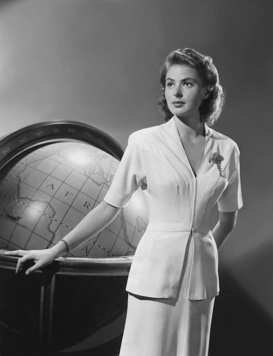 """<p>Ingrid Bergman was the epitome of '40s chic in <em>Casablanca</em><em>,</em> but her casual white two-piece suit and diamond brooch is what stands out as most memorable. Oh, and the line, """"Here's looking at you, kid."""" That too.</p>"""