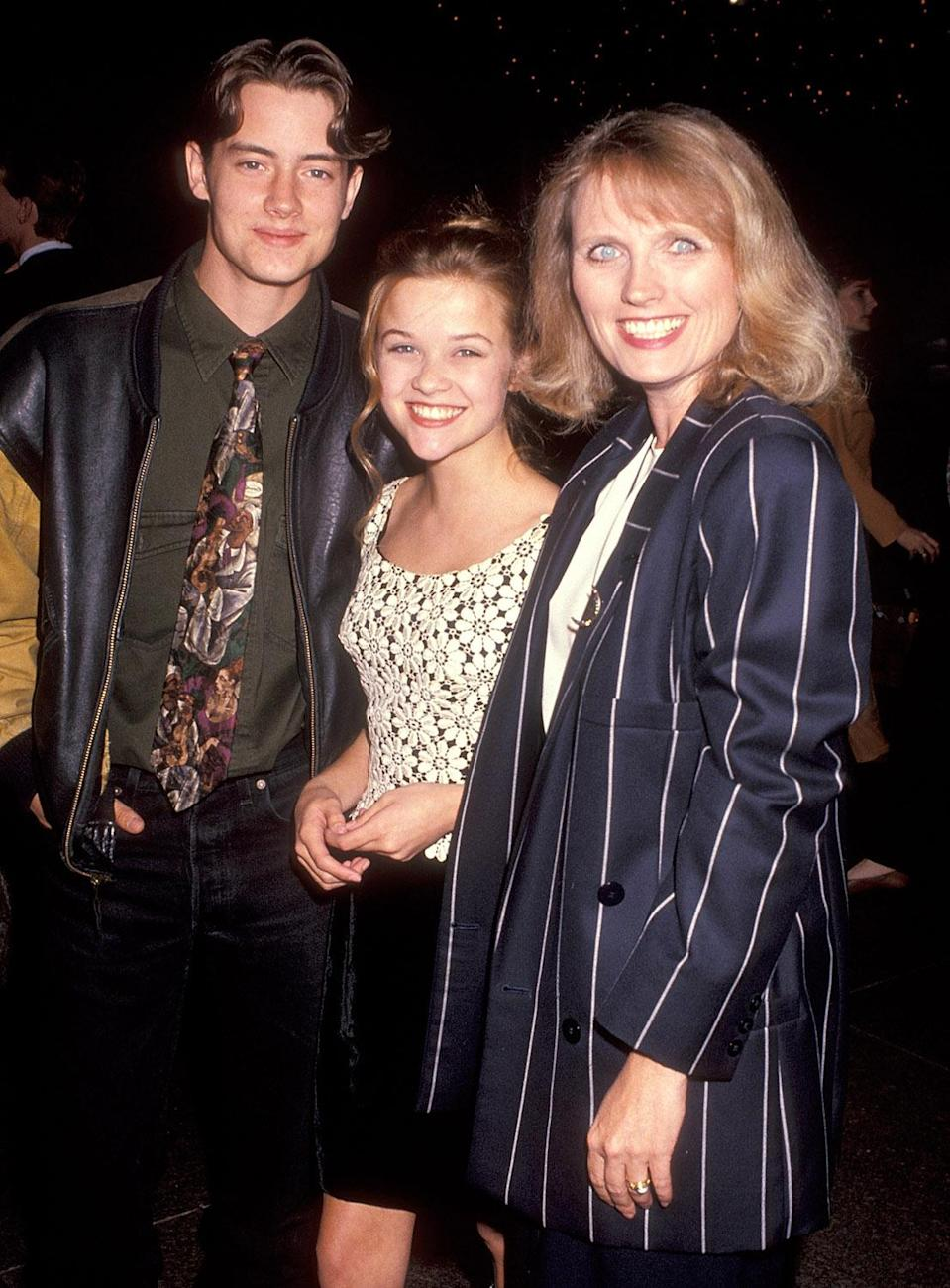 <p>Baby-faced, and just 15, Reese posed with her co-stars Jeremy London and Tess Harper at the Hollywood premiere of her feature film debut, <em>The Man in the Moon.</em><br> (Photo: Getty Images) </p>
