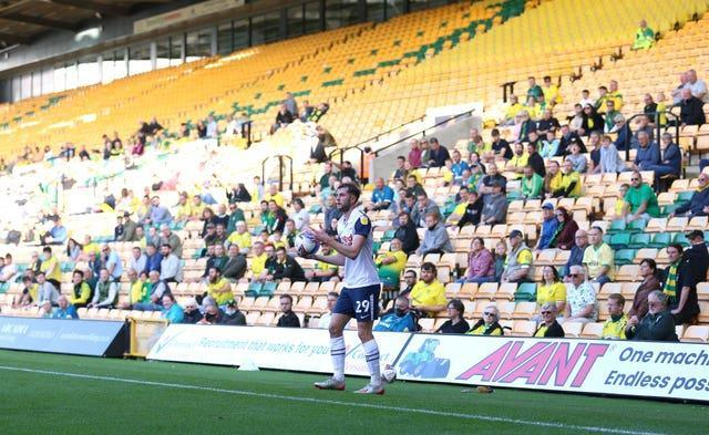 Preston North End's Tom Barkhuizen takes a throw in as fans watch at Carrow Road