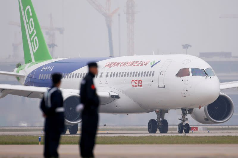 China's home-grown C919 passenger jet taxis after landing on its maiden flight at the Pudong International Airport in Shanghai