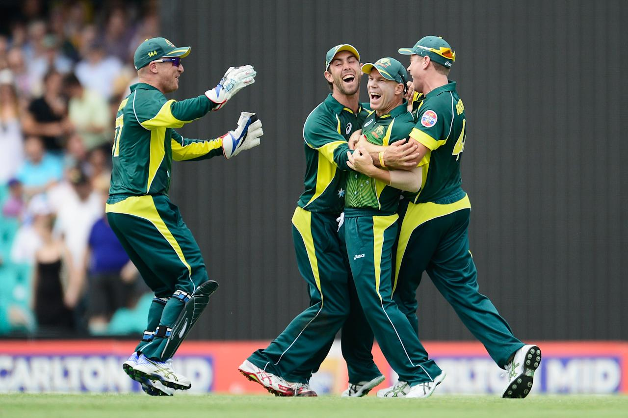 SYDNEY, AUSTRALIA - JANUARY 19: David Warner of Australia celebrates after running out Ian Bell of England during game three of the One Day International Series between Australia and England at Sydney Cricket Ground on January 19, 2014 in Sydney, Australia.  (Photo by Brett Hemmings/Getty Images)