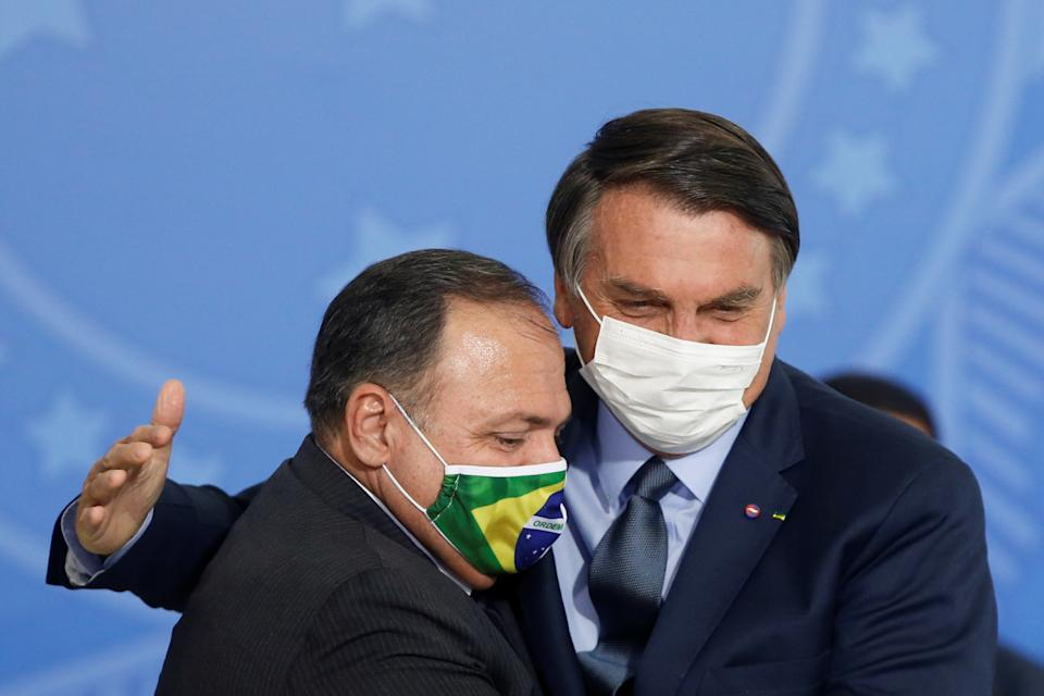 Brazil's President Jair Bolsonaro greets the new Health Minister Eduardo Pazuello during an inauguration ceremony at the Planalto Palace in Brasilia, Brazil, September 16, 2020. REUTERS/Adriano Machado