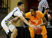 Tennessee guard Kevin Punter (0) drives past Marquette forward Sandy Cohen III (5) during the first half of an NCAA college basketball game in Lake Buena Vista, Fla., Sunday, Nov. 30, 2014. (AP Photo/Reinhold Matay)
