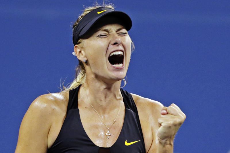 Maria Sharapova, of Russia, pumps her fist as she wins a point against Nadia Petrova, of Russia, in the fourth round of play at the U.S. Open tennis tournament, Sunday, Sept. 2, 2012, in New York. (AP Photo/Charles Krupa)