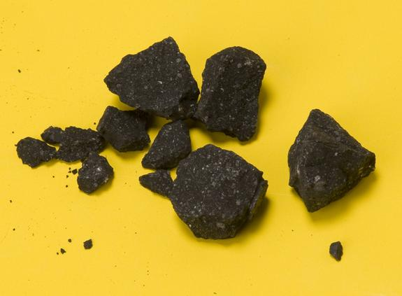 Fragments of the Sutter's Mill meteorite fall collected by NASA Ames and SETI Institute meteor astronomer Dr. Peter Jenniskens in the evening of Tuesday April 24, two days after the fall. This was the second recovered find.