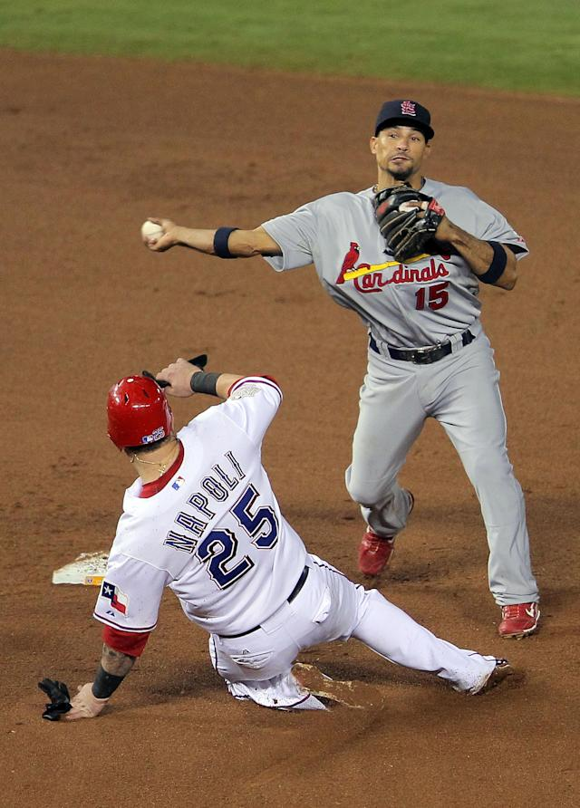 ARLINGTON, TX - OCTOBER 23: Rafael Furcal #15 of the St. Louis Cardinals turns the double play as Mike Napoli #25 of the Texas Rangers slides into second base in the eighth inning during Game Four of the MLB World Series at Rangers Ballpark in Arlington on October 23, 2011 in Arlington, Texas. (Photo by Doug Pensinger/Getty Images)