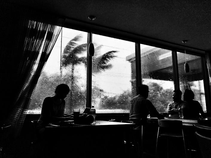 Guests sat in the lobby of the Fairfield Inn and Suites in Miami on Sept. 10 as the area was hit by 100 mph wind gusts from Hurricane Irma. (Photo: Holly Bailey/Yahoo News)