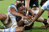 New Zealand's Sevu Reece, center, has his try attempt spoiled by the Argentine defense during their Rugby Championship match on Sunday, Sept. 12, 2021, on the Gold Coast, Australia. (AP Photo/Tertius Pickard)