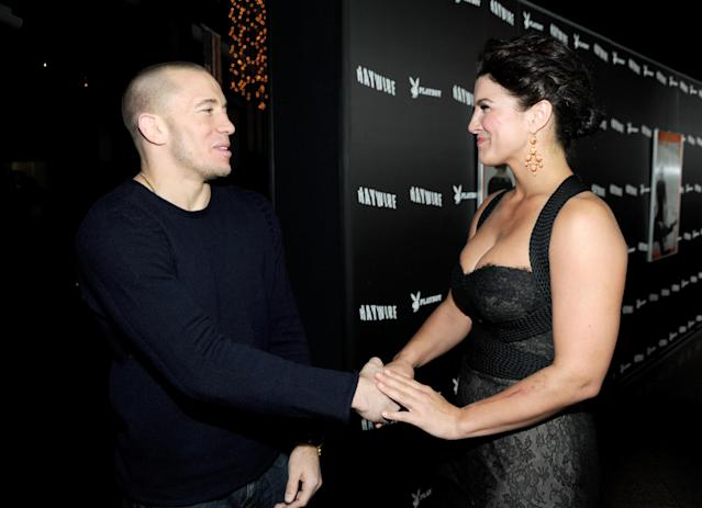 """LOS ANGELES, CA - JANUARY 05: UFC fighter Georges St-Pierre (L) and actress Gina Carano arrive at Relativity Media's premiere of """"Haywire"""" co-hosted by Playboy held at DGA Theater on January 5, 2012 in Los Angeles, California. (Photo by Frazer Harrison/Getty Images for Relativity Media)"""