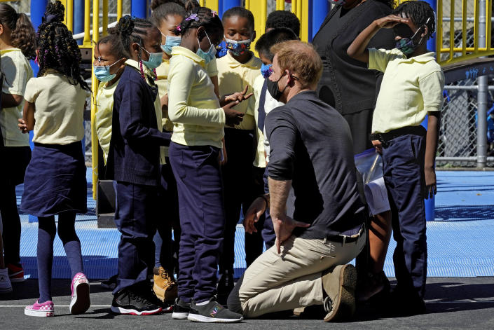 Prince Harry, the Duke of Sussex, chats with students during a visit to P.S. 123, the Mahalia Jackson School, in New York's Harlem neighborhood, Friday, Sept. 24, 2021. (AP Photo/Richard Drew)