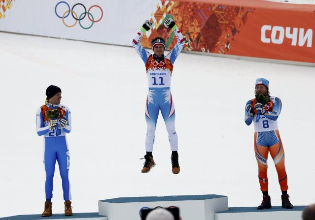 REFILE - CORRECTING TYPO Winner Austria's Matthias Mayer (C) reacts behind second-placed Italy's Christof Innerhofer (L) and third-placed Norway's Kjetil Jansrud after the men's alpine skiing downhill race during the 2014 Sochi Winter Olympics at the Rosa Khutor Alpine Center February 9, 2014. REUTERS/Mike Segar (RUSSIA - Tags: SPORT OLYMPICS SPORT SKIING TPX IMAGES OF THE DAY)