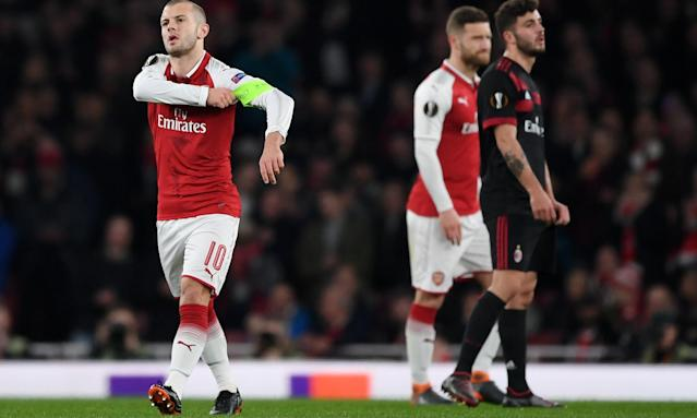 Arsenal's Jack Wilshere takes over as captain after the early injury of Laurent Koscielny in the 3-1 win over Milan.