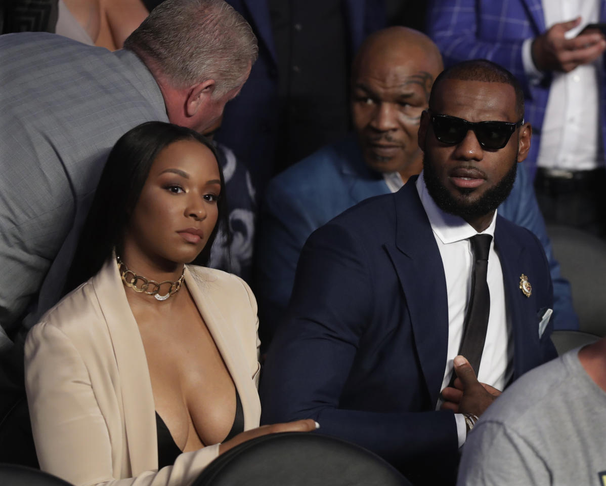 <p>LeBron James waits for a super welterweight boxing match between Floyd Mayweather Jr. and Conor McGregor on Saturday, Aug. 26, 2017, in Las Vegas. Former boxer Mike Tyson sits behind James. (AP Photo/Isaac Brekken) </p>