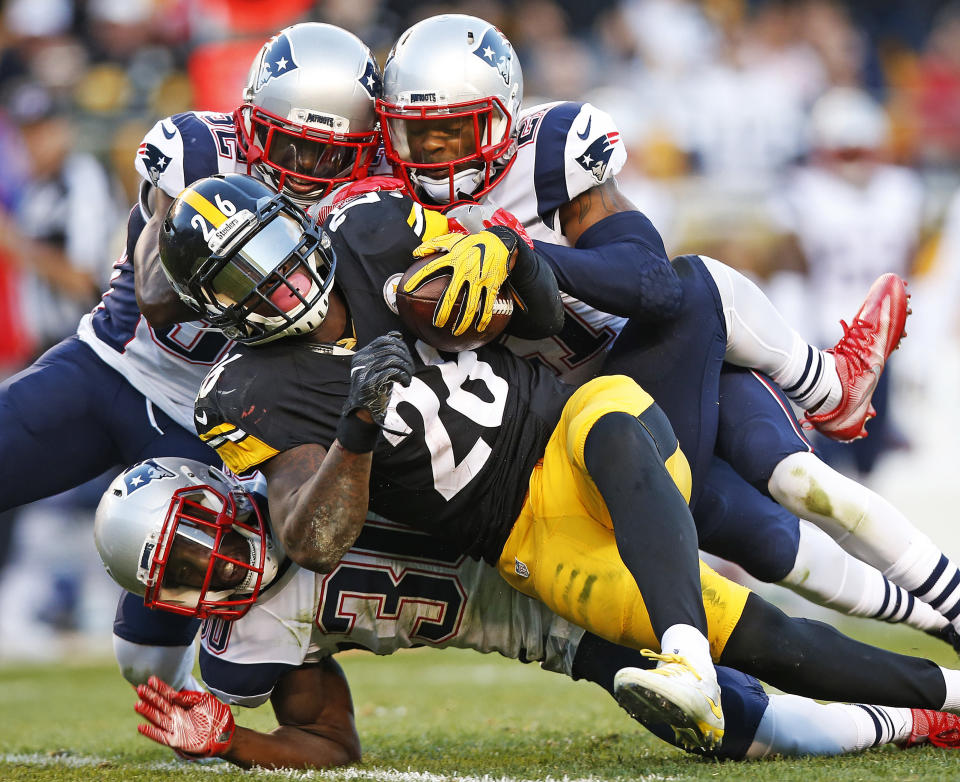 Former Steelers linebacker James Harrison says Le'Veon Bell should fake injuries to stay healthy. (AP)