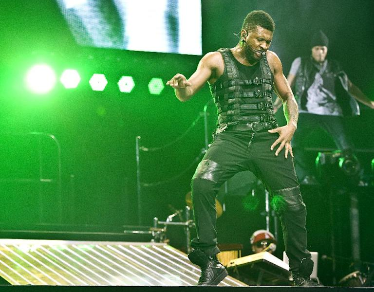 """FILE - In this Feb. 2, 2011 file photo, Usher performs at the o2 arena in London. Usher, who had electronic-flavored successes with the will.i.am-produced """"OMG,"""" """"DJ Got Us Fallin' In Love Again"""" and David Guetta's """"Without You,"""" says his new album will blend electronic and soul, and will feature Swedish House Mafia, Diplo, Klas Ahlund (the main producer behind Robyn), and Luke Steele of the Australian electronic duo Empire of the Sun. (AP Photo/Joel Ryan, file)"""