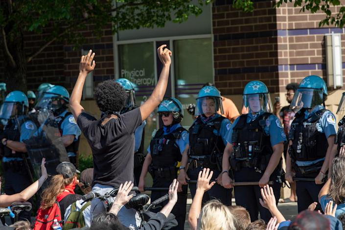 Protestors stage a peaceful sit-in outside the Chicago Police 18th district station demanding equality in police protection across the city on June 1, 2020.