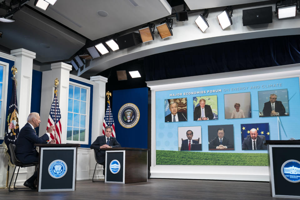 Secretary of State Antony Blinken listens as President Joe Biden delivers remarks to the Major Economies Forum on Energy and Climate, in the South Court Auditorium on the White House campus, Friday, Sept. 17, 2021, in Washington. (AP Photo/Evan Vucci)