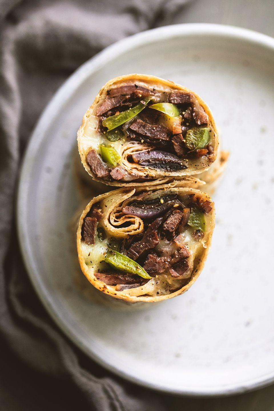 """<p>Same sandwich you love, brand new form.</p><p>Get the recipe from <a href=""""https://www.delish.com/cooking/recipe-ideas/recipes/a53593/philly-cheesesteak-wraps-recipe/"""" rel=""""nofollow noopener"""" target=""""_blank"""" data-ylk=""""slk:Delish"""" class=""""link rapid-noclick-resp"""">Delish</a>. </p>"""