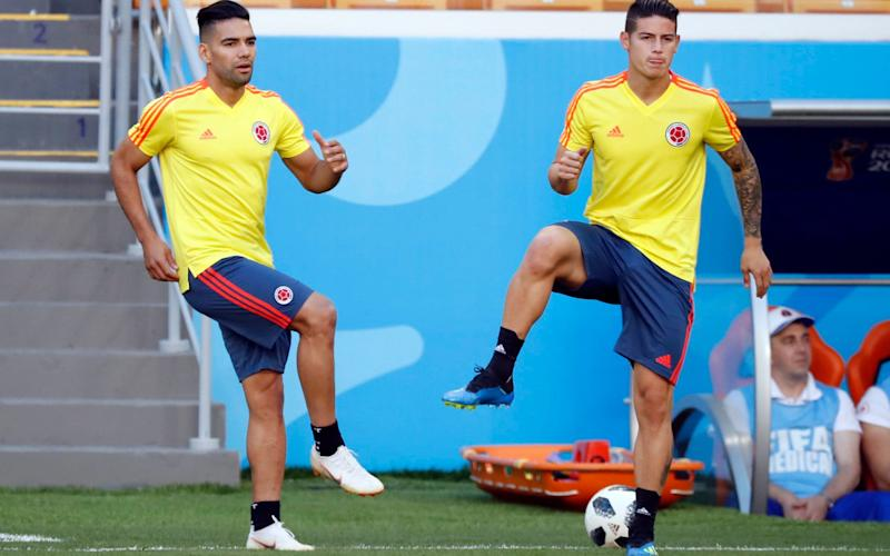 Radamel Falcao (left) and James Rodriguez warm up on the eve of Colombia's opening game of the World Cup, the Group H meeting with Japan at the Mordovia Arena in Saransk - AP