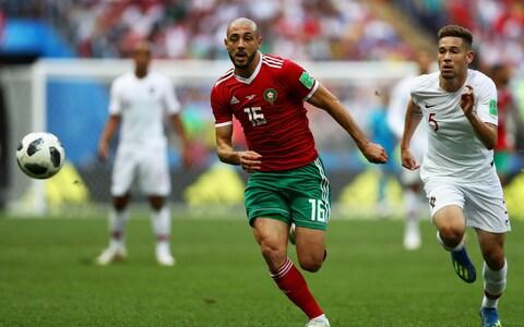 Nordin Amrabat of Morocco gets past the tackle from Raphael Guerreiro of Portugal - Credit: GETTY IMAGES