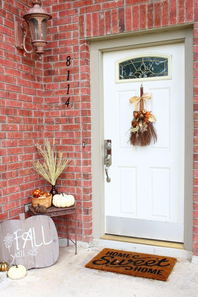 """<p>A thrift store duster transforms into a witch's broom in this simple scene. And how fun is that pumpkin-shaped sign?</p><p><strong>Get the tutorial at <a href=""""https://domesticallycreative.com/rustic-fall-cinnamon-broom-wreath"""" rel=""""nofollow noopener"""" target=""""_blank"""" data-ylk=""""slk:Domestically Creative"""" class=""""link rapid-noclick-resp"""">Domestically Creative</a>.</strong></p><p><a class=""""link rapid-noclick-resp"""" href=""""https://go.redirectingat.com?id=74968X1596630&url=https%3A%2F%2Fwww.walmart.com%2Fsearch%2F%3Fquery%3Dfaux%2Bfall%2Bleaves&sref=https%3A%2F%2Fwww.thepioneerwoman.com%2Fholidays-celebrations%2Fg32894423%2Foutdoor-halloween-decorations%2F"""" rel=""""nofollow noopener"""" target=""""_blank"""" data-ylk=""""slk:SHOP FAUX FALL LEAVES"""">SHOP FAUX FALL LEAVES </a></p>"""