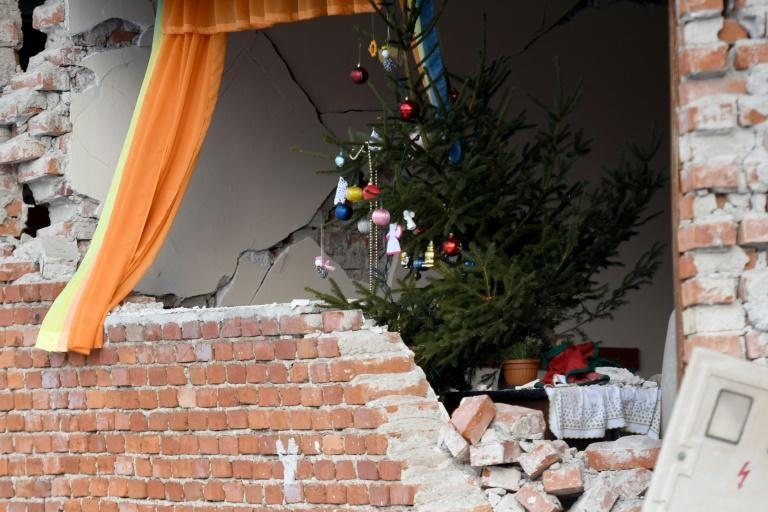 The quake killed seven people and cracked open buildings, schools and farm structures