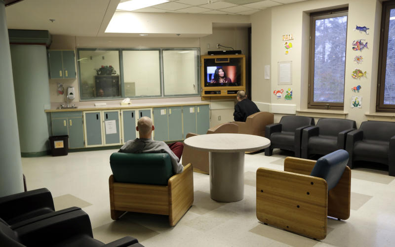 FILE - In this Nov. 18, 2015, file photo, patients at Western State Hospital in Lakewood, Wash., watch television. Hundreds of employees at Washington state's largest psychiatric hospital have suffered serious injuries during assaults by patients, resulting in millions of dollars in medical costs and thousands of missed days of work. (AP Photo/Ted S. Warren, File)