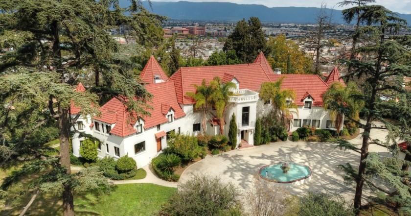 Known as the Pyrenees Castle, the 1925 mansion sits behind walls and gates on a 2.6-acre knoll in Alhambra.