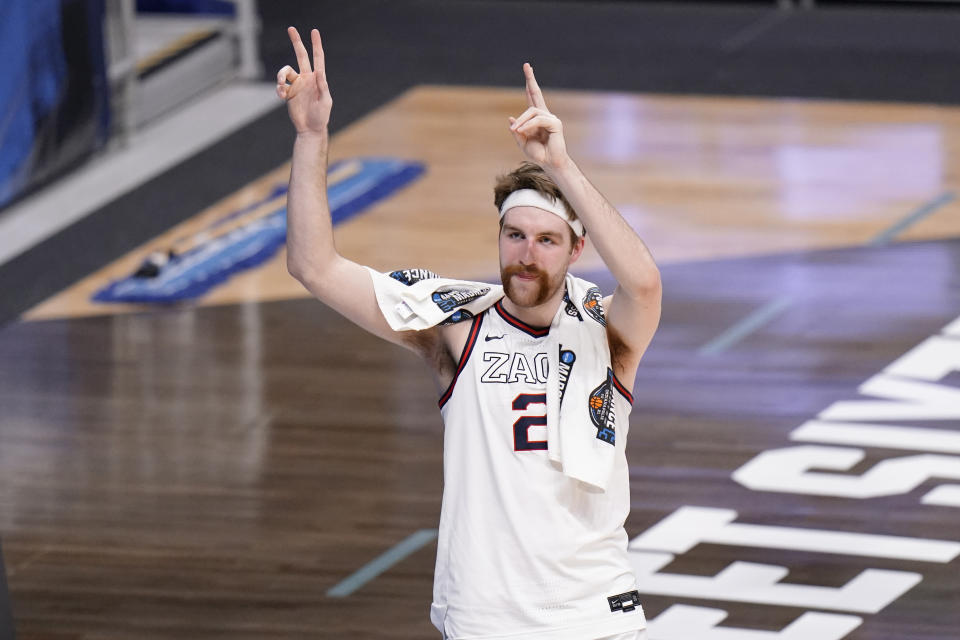 Gonzaga forward Drew Timme waves to fans after beating Creighton 83-65 in a Sweet 16 game in the NCAA men's college basketball tournament at Hinkle Fieldhouse in Indianapolis, Sunday, March 28, 2021. (AP Photo/AJ Mast)