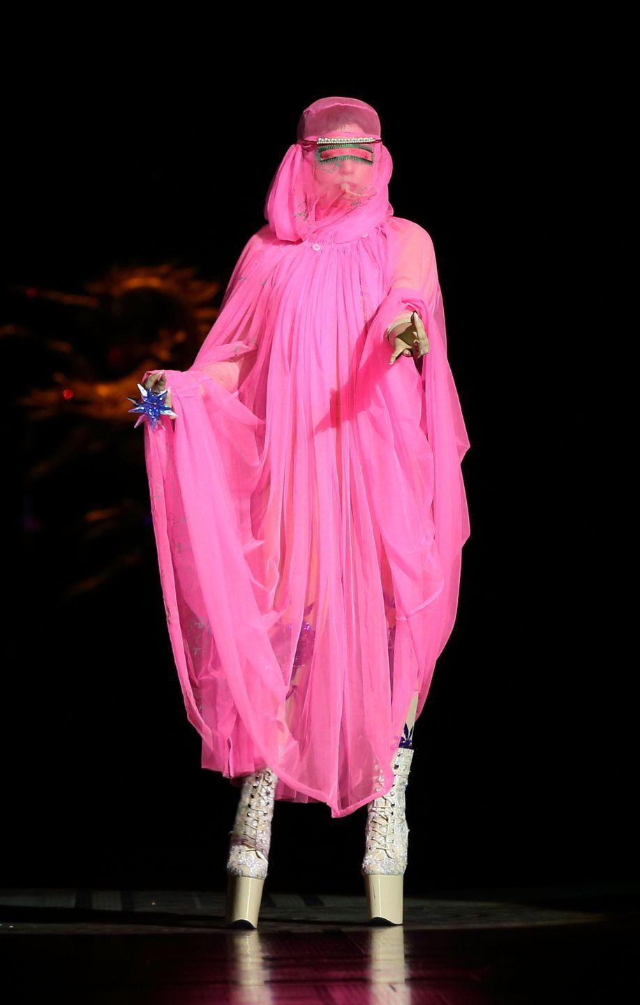 """<p>There was some controversy around this hot pink burqa-like dress that Lady Gaga wore at a Philip Treacy fashion show in 2012. An article published in <em>The Atlantic </em>accused Lady Gaga of """"fetishiz[ing] the women of another culture in order to sell records."""" </p>"""