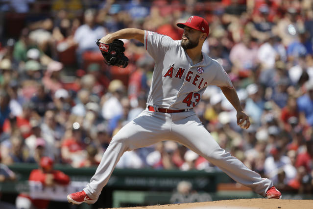 Los Angeles Angels starter Patrick Sandoval winds up for a pitch against the Boston Red Sox in the first inning of a baseball game at Fenway Park, Sunday, Aug. 11, 2019, in Boston. (AP Photo/Steven Senne)