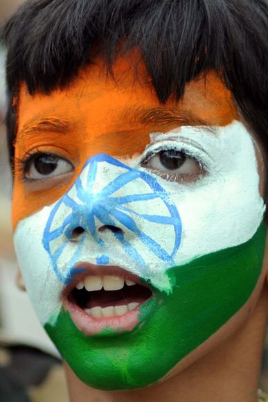 Indian school children perform during celebrations on the eve of Independence Day at India-Pakistan Wagah Border Post on August on 14, 2012.  Pakistan celebrates Independence Day on August 14 and India on August 15.   AFP PHOTO/NARINDER NANU