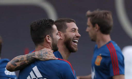 Spain's Sergio Ramos, center, smiles with his teammates during a training session of Spain at the 2018 soccer World Cup in Krasnodar, Russia, Sunday, June 17, 2018. (AP Photo/Manu Fernandez)
