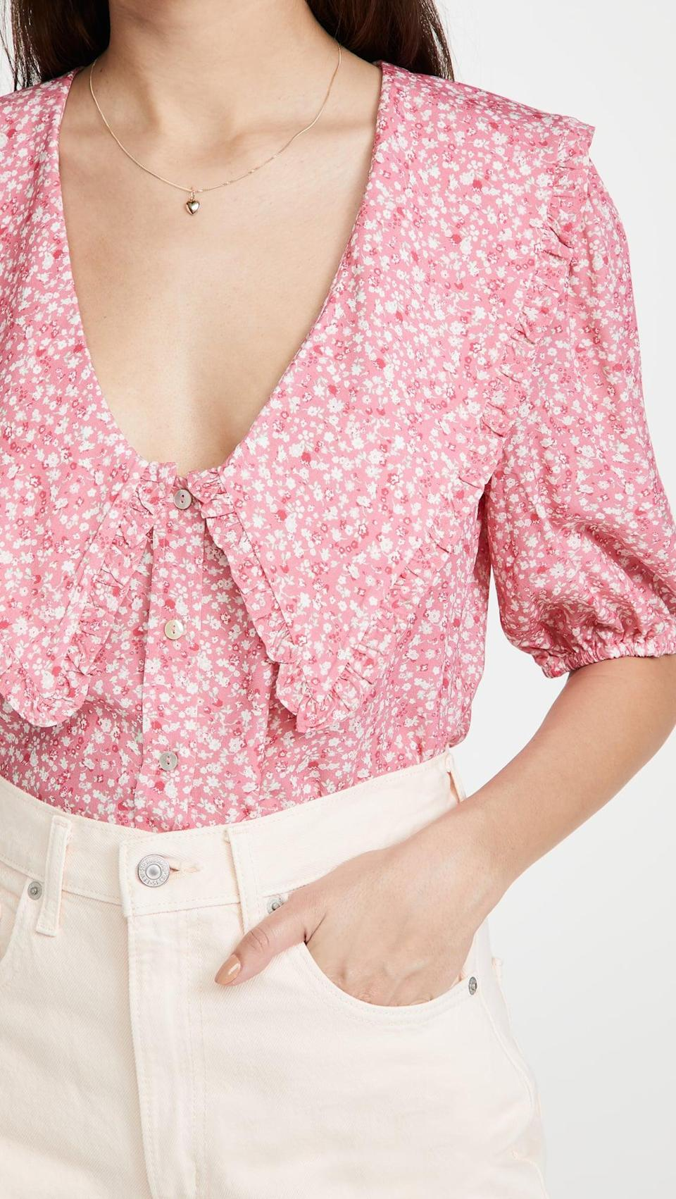 <p>This <span>WAYF Amie Button Up Blouse</span> ($55) would look cute with white trousers.</p>